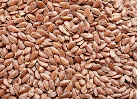 close up of flax seeds on white background  photo