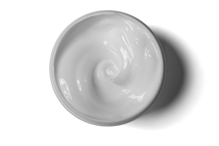 close up of a white beauty cream on white background with clipping path photo