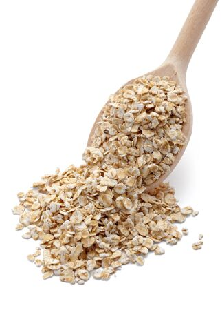 oats: close up of oat flakes in wooden spoon on white background with clipping path