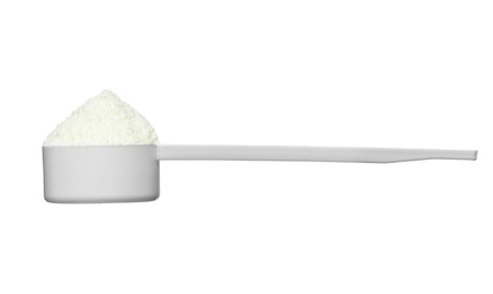 powdered: close up of powdered milk and spoon for baby on white background with clipping path Stock Photo