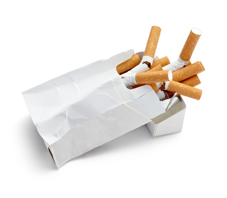 close up of a trashed box of cigarettes on white background with clipping path photo