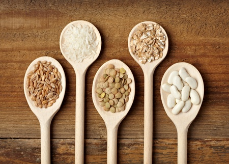 collection of various food ingrediants in wooden spoon  photo