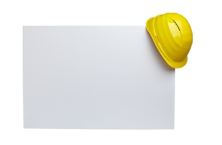 construction paper: close up of  a yellow construction helmet on white blank note white background with clipping path Stock Photo