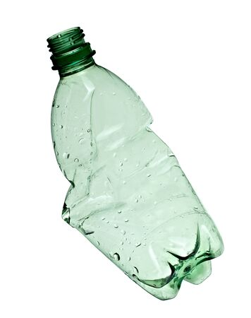 close up of an empty used plastic bottle on white background with clipping path photo