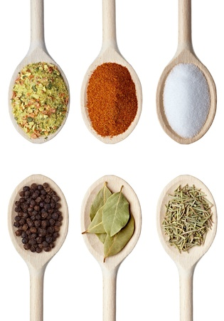 collection of various food ingrediants in wooden spoon on white background. each one is shot separately photo