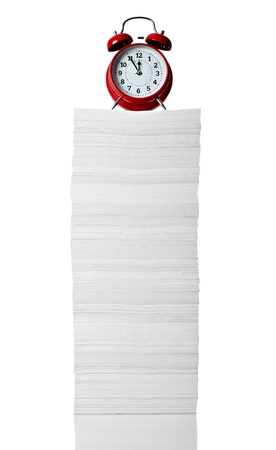 close up of stack of papers and clock on white background  photo