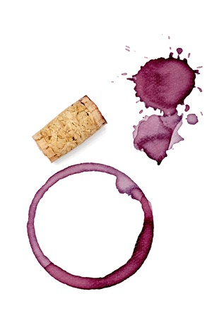 spill: close up of  a wine stains and cork opener on  white background  Stock Photo
