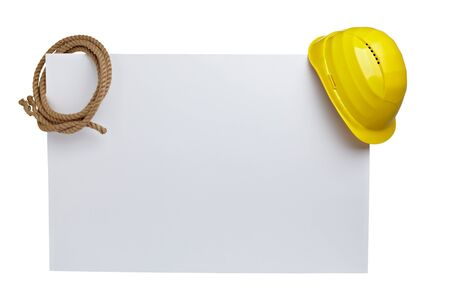 close up of  a yellow construction helmet and rope on white blank note white background photo