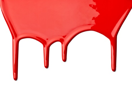 red paint: close up of red paint leaking on white background Stock Photo