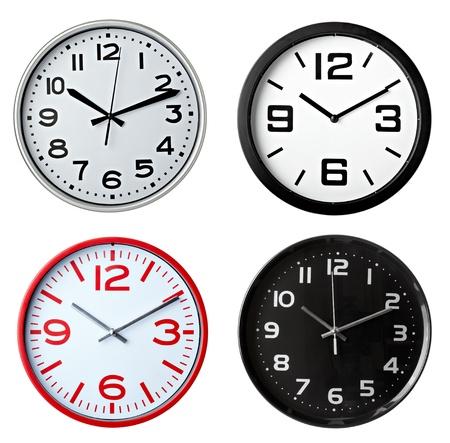 reloj pared: colecci�n de oficina varios relojes sobre fondo blanco. cada uno recibe un disparo por separado