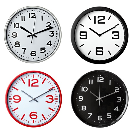 collection of various office clocks on white background. each one is shot separately photo