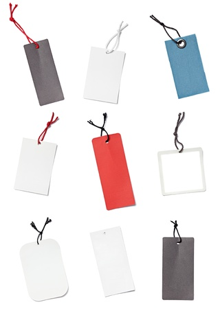 collection ofvarious blank price labels on white background. each one is shot separately photo