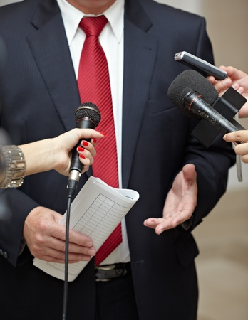 close up of conference meeting microphones and businessman  Stock Photo - 10227251