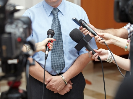 media equipment: close up of conference meeting microphones and businessman
