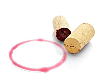 red wine stain: close up of  a wine stains and cork opener on  white background with clipping path Stock Photo