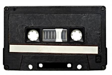 close up of vintage audio tape on white background photo
