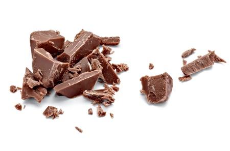 miettes: pr�s de morceaux de chocolat sur fond blanc Banque d'images