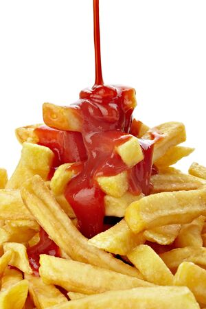 ketchup: close up of french fries and ketchup on white background  Stock Photo