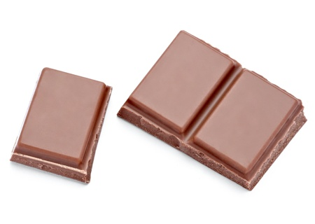 close up  of chocolate pieces on white background  photo