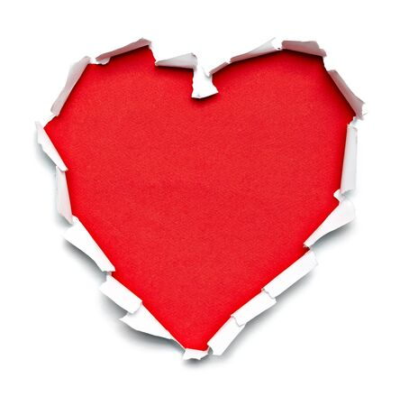 to break through: close up of  a ripped paper hole heart shaped on white background