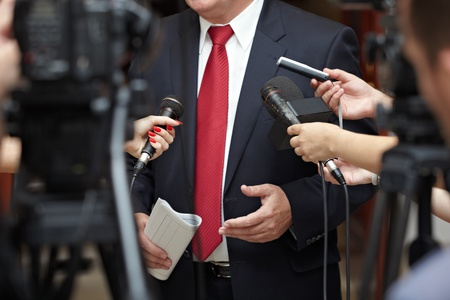 close up of conference meeting microphones and businessman  photo