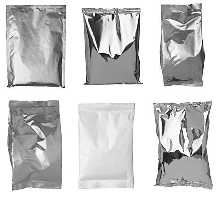 foil: collezione di borse in alluminio varie su sfondo bianco. ognuno � girato separatamente Archivio Fotografico