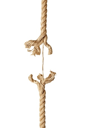 weakness: close up  of a damaged rope on white background  Stock Photo