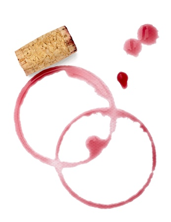 red wine stain: close up of  a wine stains and cork opener on  white background Stock Photo