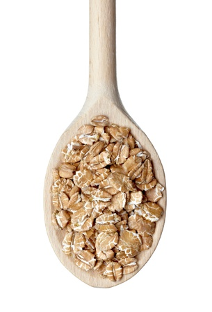 close up of wheat flakes in wooden spoon on white background with clipping path Stock Photo - 10386009