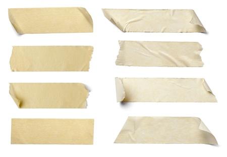 cintas: colecci�n de varios trozos de cinta adhesiva sobre fondo blanco. cada uno recibe un disparo por separado
