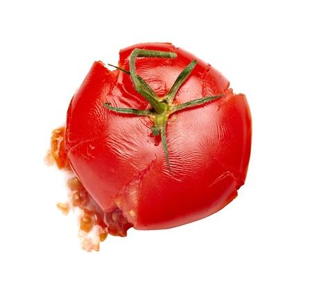 splattered: close up of  a splattered tomato on white background