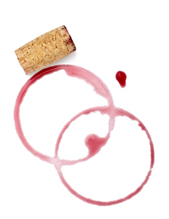 cork screw: close up of  a wine stains and cork opener on  white background with clipping path Stock Photo
