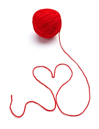 skein: close up of  a wool ball and heart shape on white background Stock Photo