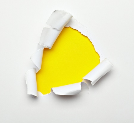 close up of  a ripped paper hole on white background photo