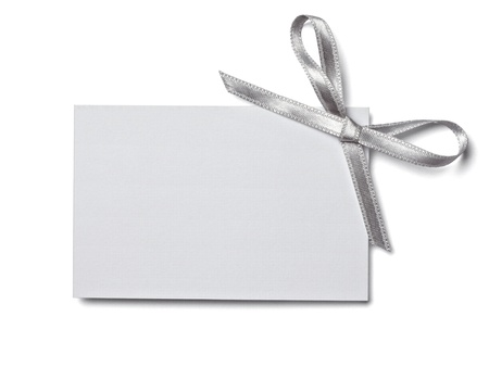 silver ribbon: close up of  card note with  ribbon on white background  with clipping path Stock Photo