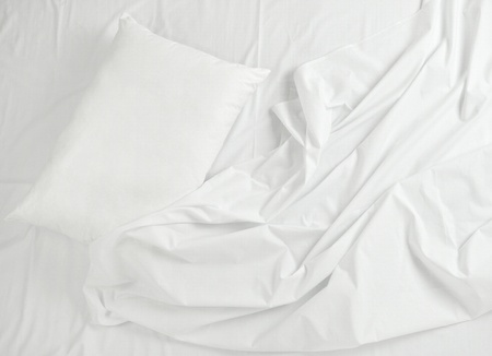 close up of bedding sheets and pillow photo