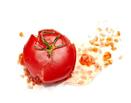 smashed: close up of  a splattered tomato on white background