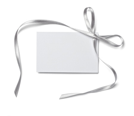 silver christmas: close up of  card note with  ribbon on white background  Stock Photo