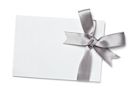 silver ribbon: close up of  card note with  ribbon on white background  Stock Photo