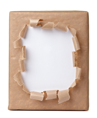 wrapped up: close up of a ripped wrapped box on white background