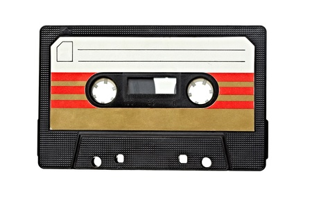 close up of vintage audio tape on white background