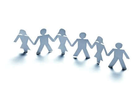 group chain: close up of  paper people on white background  Stock Photo