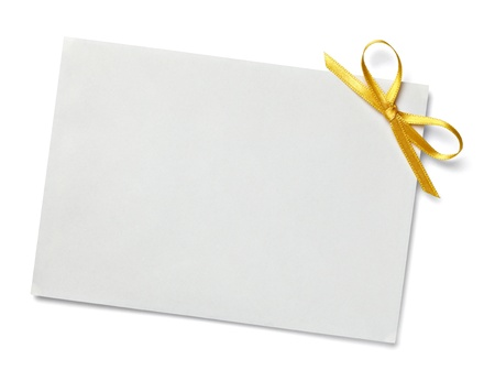 gold string: close up of  card note with  ribbon on white background