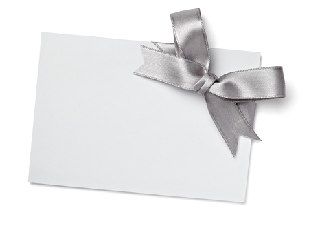 silver ribbon: close up of  card note with  ribbon on white background