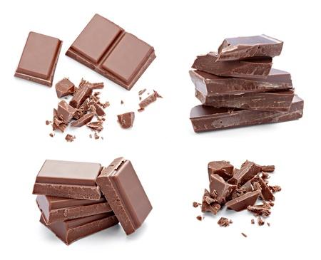 collectie van verschillende chocolade stukken op witte achtergrond. elk wordt afzonderlijk neergeschoten