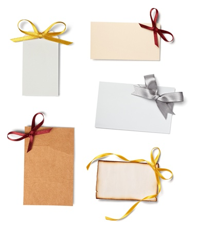 collection of  various card notes with ribbon on white background.each one is shot separately  photo