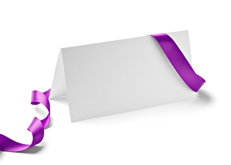 purple ribbon: close up of  card note with  ribbon on white background  with clipping path Stock Photo