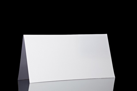 close up of  a folded card on black  background  with clipping path photo