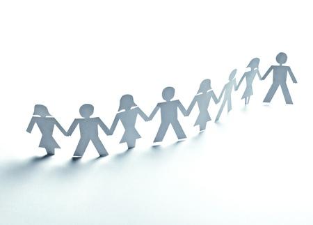 trabajo social: cerca de la gente de papel sobre fondo blanco