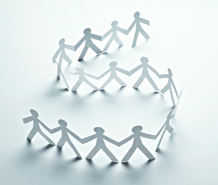 community help: close up of  paper people on white background  Stock Photo